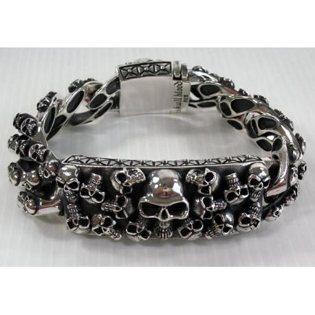 Мужской серебряный браслет с черепами