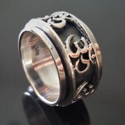 """Вращающееся кольцо """"Ом"""""""
