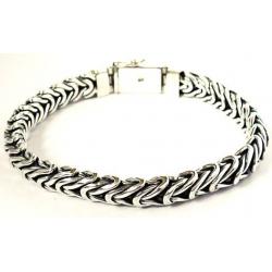 Плетенный серебряный браслет